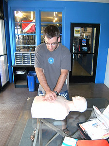 Doing chest compressions on the mannequin